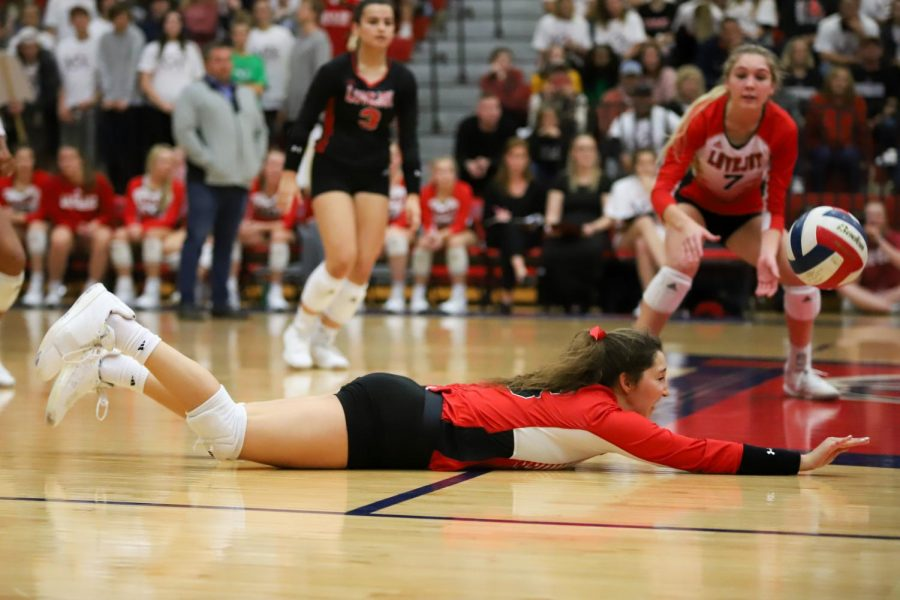 Senior Emma Johnson dives after Centennial tipped the ball over to keep the ball in play.