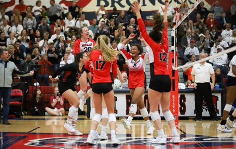 The Leopards celebrate on the court after a 25-22 third set win against Frisco Centennial. The Leopards will move onto area on Thursday, Nov. 7.