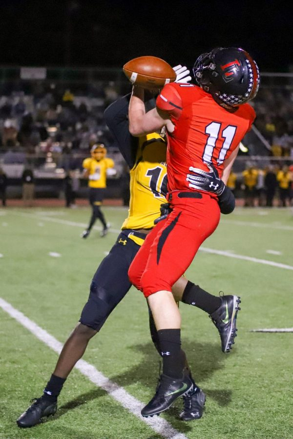 Junior Chief Collins elevates up to catch the ball during the first quarter of the game.