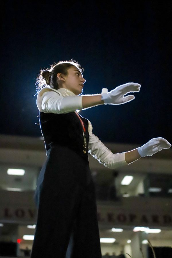 Senior drum major Lily Hager leads the band for the last time in their last performance of 'Juliet' on the field.
