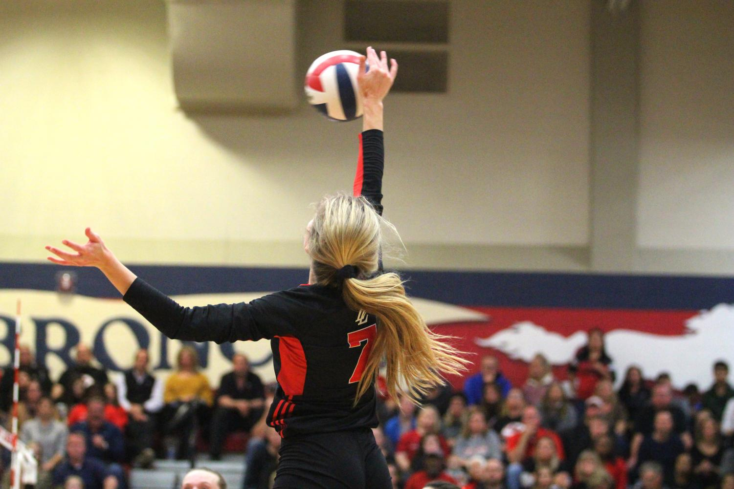 Junior Ellie Jonke hits the ball from the outside hitter position to Liberty's Libero, scoring a point for Lovejoy.