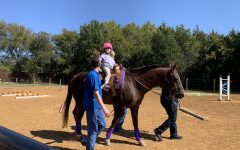 Grall is unable to walk due to spina bifida, however her hippotherapy sessions aim to help her walk one day.