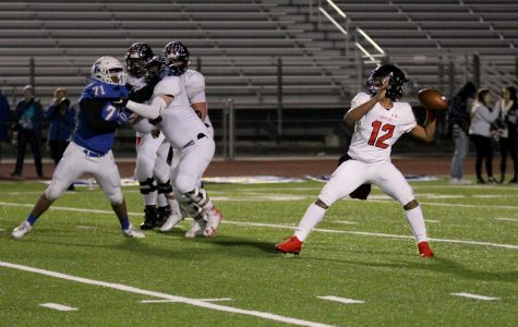 Sophomore Noah Naidoo throws the ball to wide receiver Bo Allen. Naidoo filled in as the quarterback for Ralph Rucker in this game.