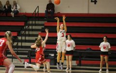 Senior Guard Grace Bennett shoots a three-pointer.