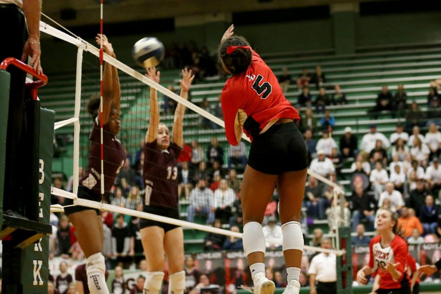 Junior Cecily Bramschreiber hits the ball past the front line of Red Oak. Bramschreiber is a TCU volleyball commit.