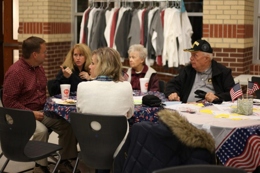 +An+Army+Veteran+and+his+family+enjoy+their+dinner+with+the+other+attending+veterans.+The+Veterans+were+able+to+talk+to+each+other+and+exchange+stories.%0A%0A