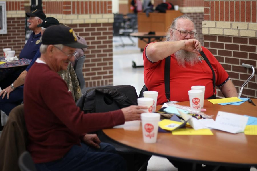 Don lange (right) shares their story and finds common ground about his experiences with a fellow veteran. Later during the Veteran's Day Dinner on Monday Dr. Mike Goddard, the Lovejoy Superintendent, asks the veterans about their experiences in the military.