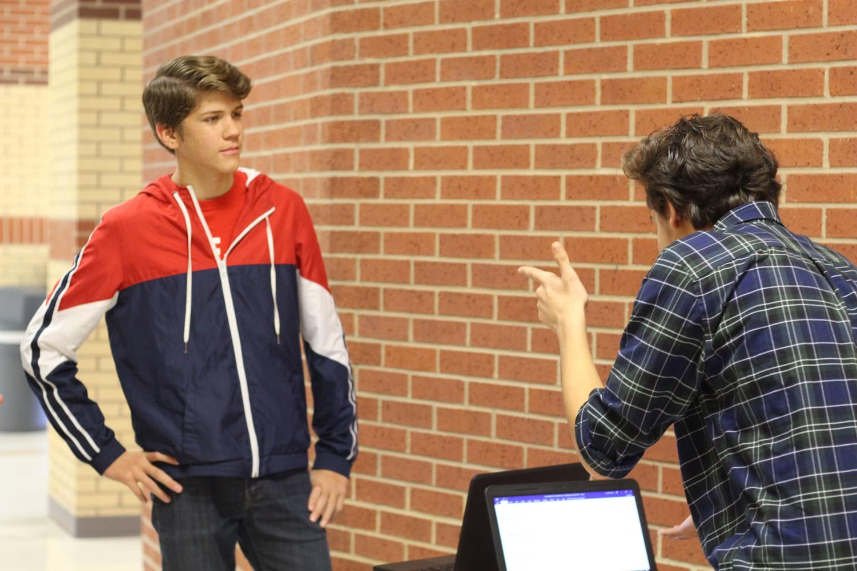 Freshmen Devon Larimer and Marco Laos practice for the upcoming meet.