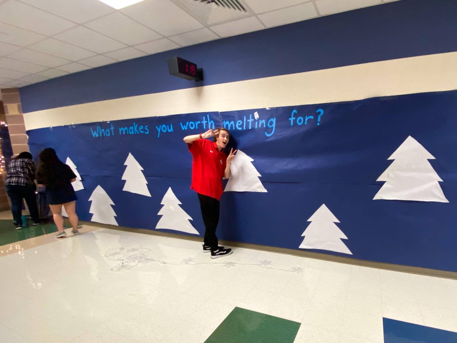 """The life skills room is decorated with the theme of Frozen. They are having kids write why they are """"worth melting for"""" on the wall of paper."""
