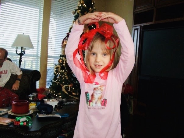 Editor-In-Chief Madeline Sanders dances with ribbon around her head on Christmas day in 2010.