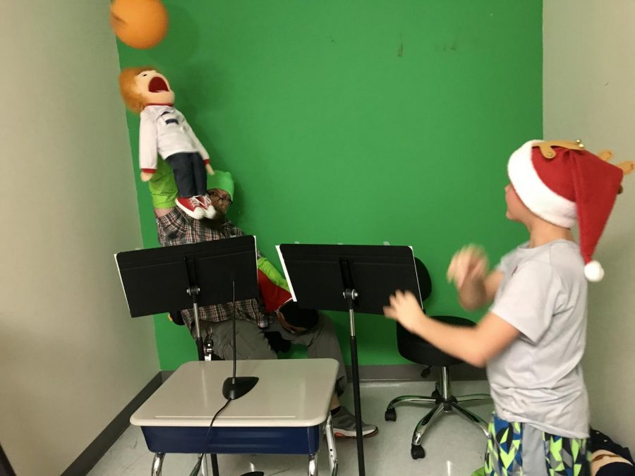 A puppet is hit with a ball during a practice taping of the newest episode. The series played during announcements, discusses topics such as respect and responsibility.
