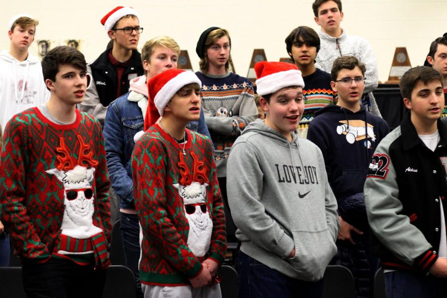 Students+in+choir+warm+up+prior+to+leaving+to+deliver+the+carol-o-grams