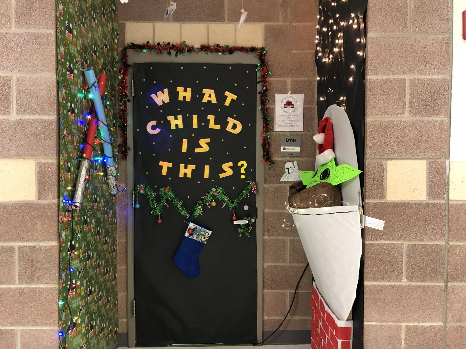 English teacher Lindsay Hamilton's door follows a star wars theme and features the current pop culture icon 'Baby Yoda.'