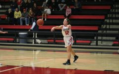 Senior point guard Mallory Adamson makes an outlet pass in her own end of the court.