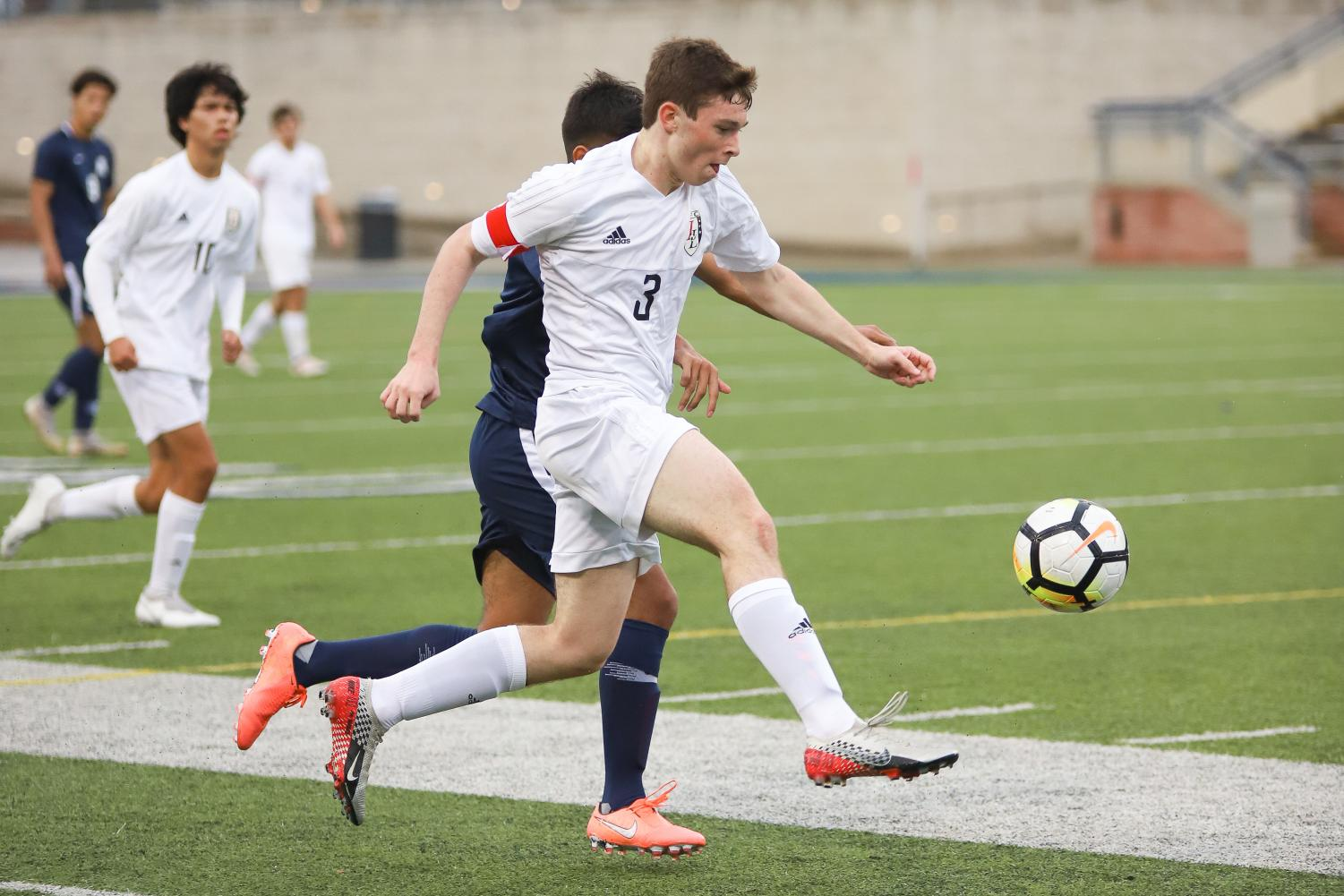 Junior Michael Myers takes possession of the ball during the first half of the game against Allen.