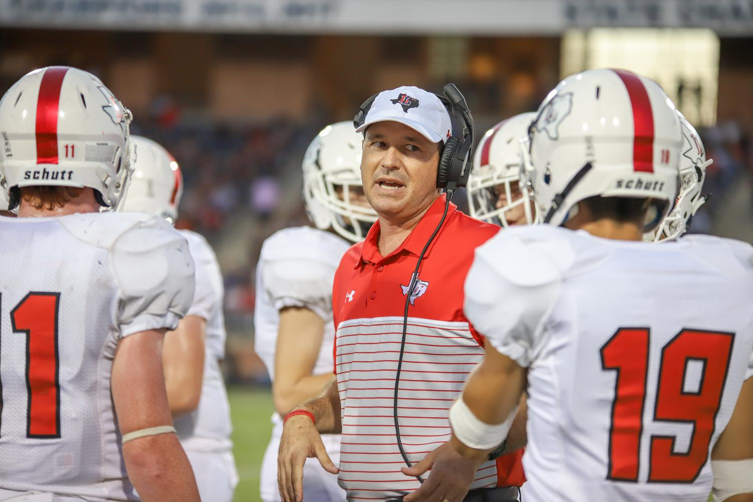 Head football coach Todd Ford talks to his offensive players during the 2019 Tom Landry Classic where the Leopards fell to the Colleyville Heritage panthers 13-10.
