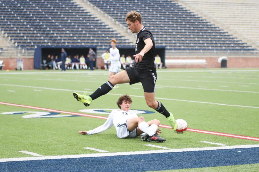 Junior Riley O'Donnell leaps over Flower Mound's Sebastian Palma to avoid a tackle.
