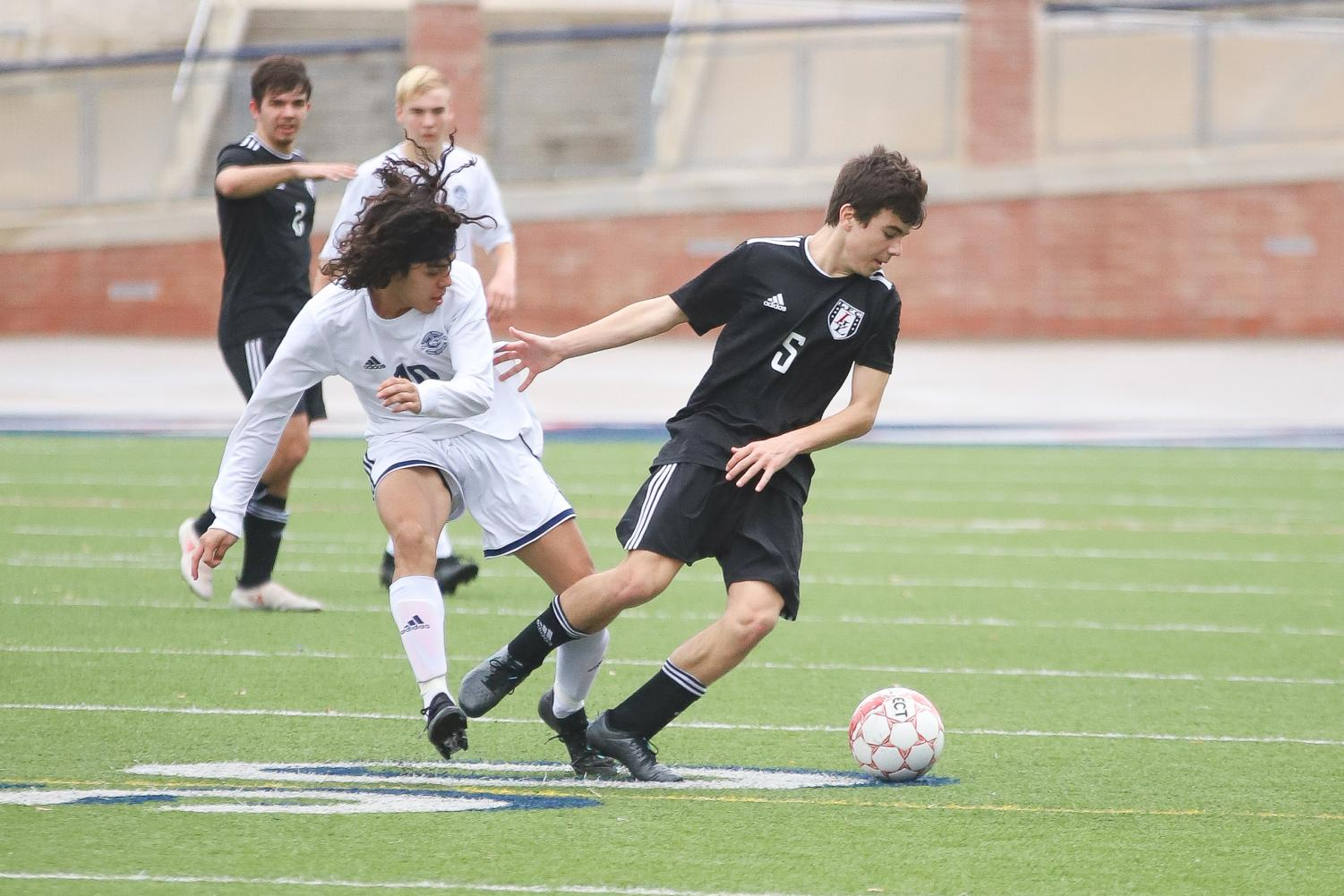 Sophomore Michael Beaney takes posession of the ball during the first quarter of the game against Flower Mound.