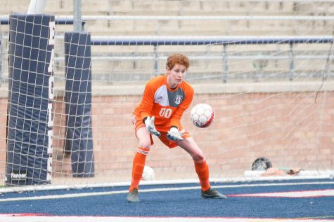 Junior Sammy Merrick makes a save in the box during the second half.