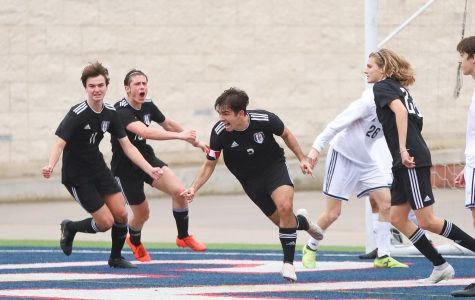 Senior Michael Branch celebrates after heading the ball in the goal with less than 10 minutes left of the second half with juniors Brandon White, Gavin Goodrich, and Cade Novicke.