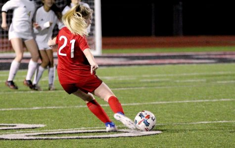 Freshmen Callan Snider take a free kick at the 20-yard-line. She misses the shot blocked by The Colony's goalie.