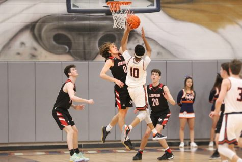 Senior Kolby McSpadden blocks a shot by Mckinney North