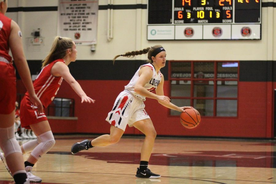 Junior Julia Brochu develops a play at the the top of the key against Ursulin. The Leopards ultimately prevailed in a 40-39 contest.