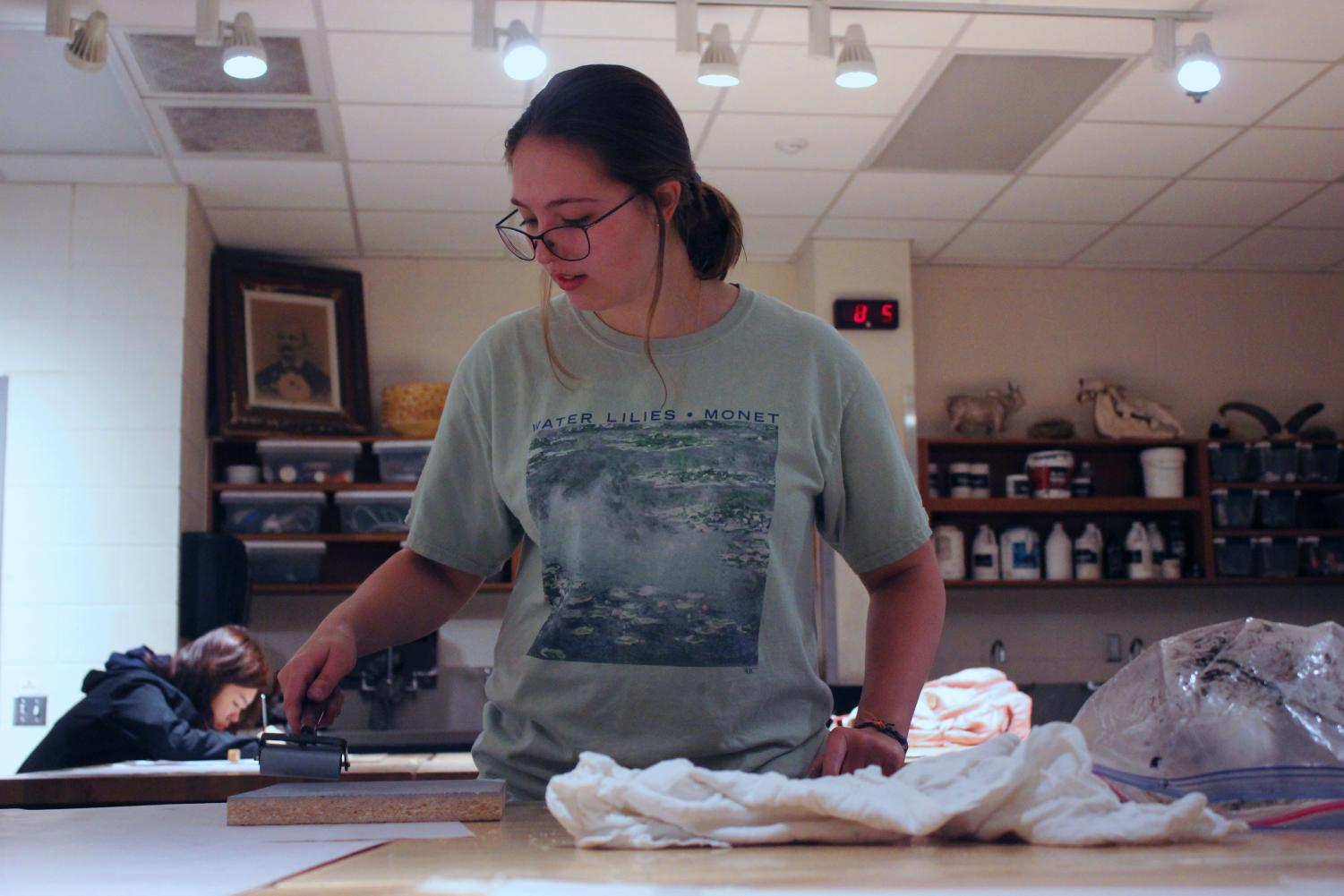 Junior Kiley Boots, does printmaking early in the morning for her portfolio. It is her second project this semester.