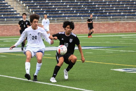 Senior Diego Rodriguez fights for possession of the ball.