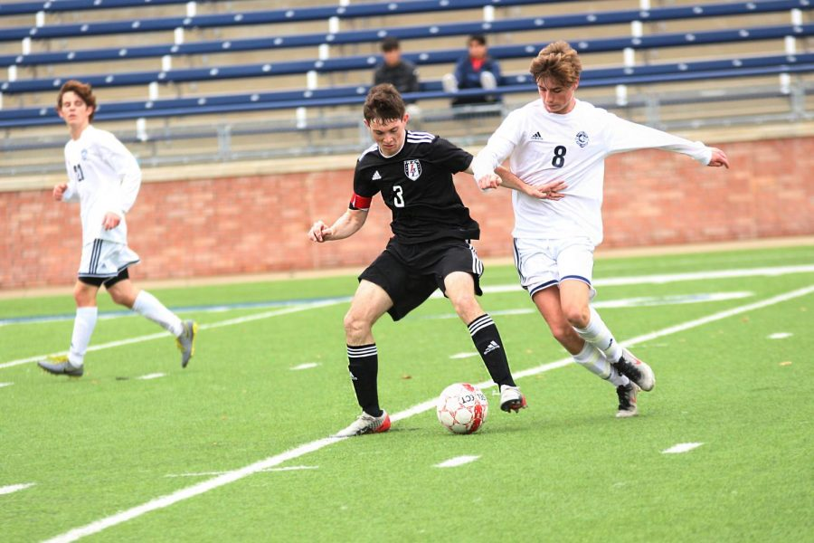Junior Michael Myers takes the ball away from Flower Mound.