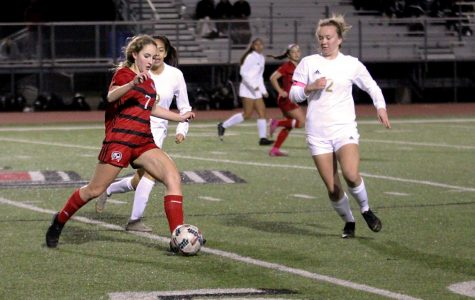 Sophomore Tatum Chester dribbles around two of The Colony's midfielders. This is the Lady Leopard's first pre-district game.