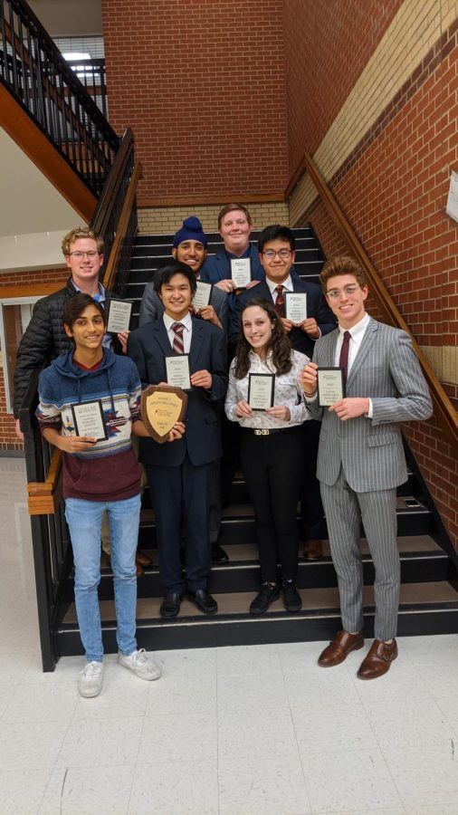 The+National+Speech+and+Debate+Qualifiers+pose+with+their+respective+awards+following+a+tournament.+