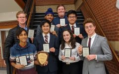 The National Speech and Debate Qualifiers pose with their respective awards following a tournament.
