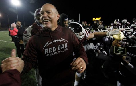 New head coach and assistant athletic director celebrates a win with his past team of Red Oak.