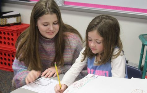 Senior Emily Lawler helps a Puster elementary school student with classwork. Emily took Ready, Set, Teach to prepare for becoming an elementary school teacher.