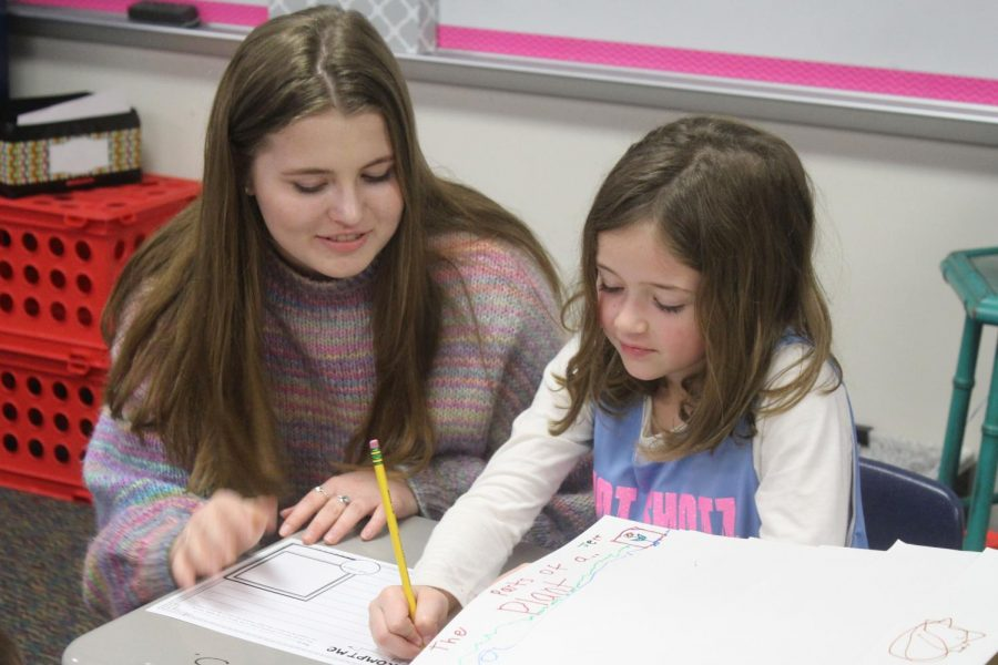 Senior+Emily+Lawler+helps+a+Puster+elementary+school+student+with+classwork.+Emily+took+Ready%2C+Set%2C+Teach+to+prepare+for+becoming+an+elementary+school+teacher.+