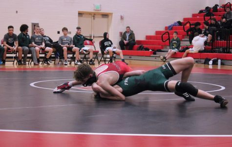 Sophomore Zach Darrow wrestles his opponent during his match on Jan. 28. Last Thursday, the wrestling achieved the school's first at a district competition.