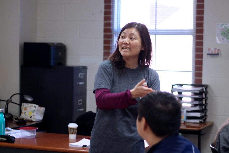 Chinese Teacher, Tina Lee, teaches her class the Mandarin language. The students have completed several projects involving Mandarin throughout the year.