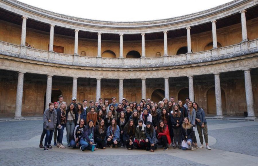 Students on the 2019 trip abroad to Spain pose in the Charles V palace of the Alhambra.