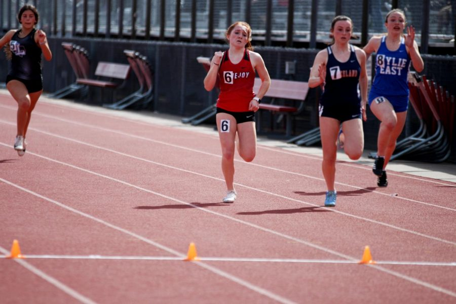 Freshmen Taylor Murphy competes for first place in the 100-meter-dash. Murphy also runs in the 4x200 and 4x100 relays.