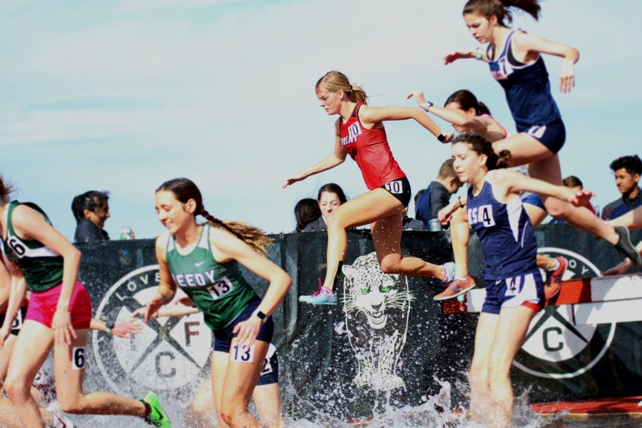 Senior Sara Rouse competes in the steeplechase race.