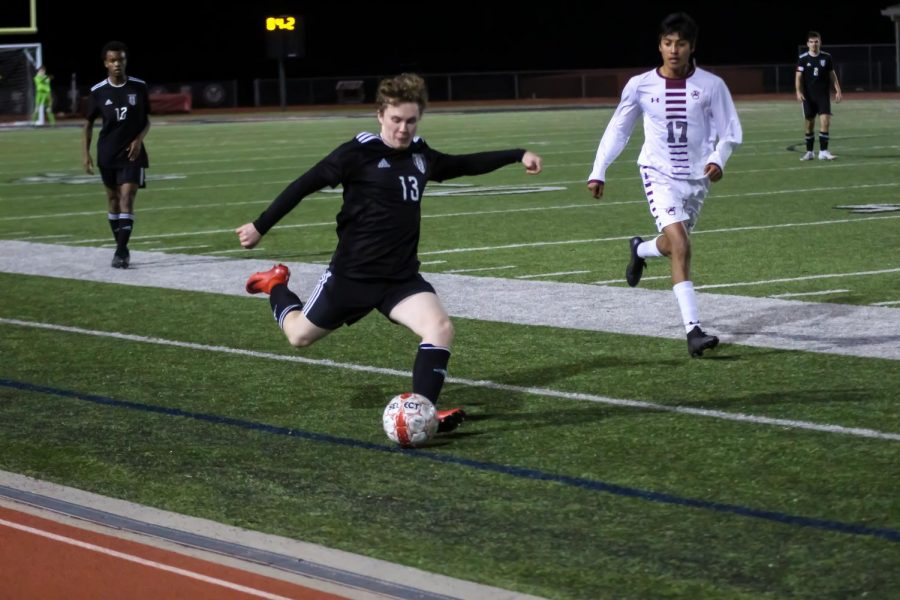 Senior Jake McTee passes the ball in order to keep it away from the other team. The team beat Sherman in overtime.
