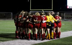 The Lady Leopards huddle before the game. The team takes a moment to take about game tactics before every game.