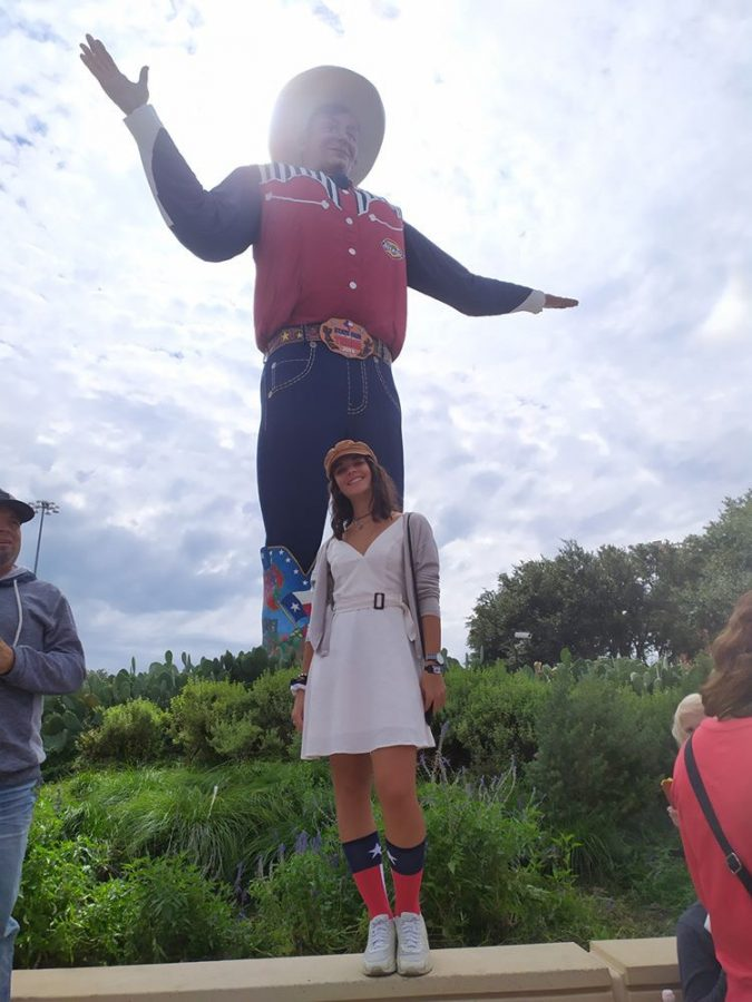 Anna Cormio stands in front of of Big Tex at the Texas State Fair during her time as an exchange student.