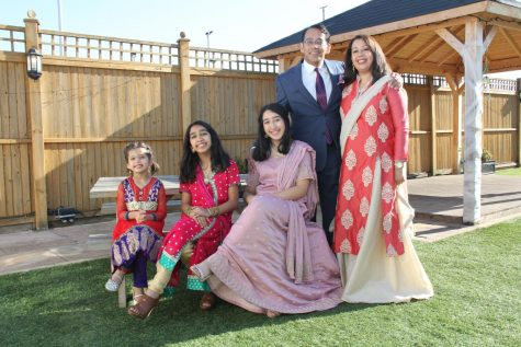 From left to right: Sidra Khan, Myra Khan, junior Sahar Khan, Imran Khan, and Mahjabeen Khan. Sidra and Myra are wearing their fancy shalwar kameez and Sahar and her mom are in their sharara dresses.