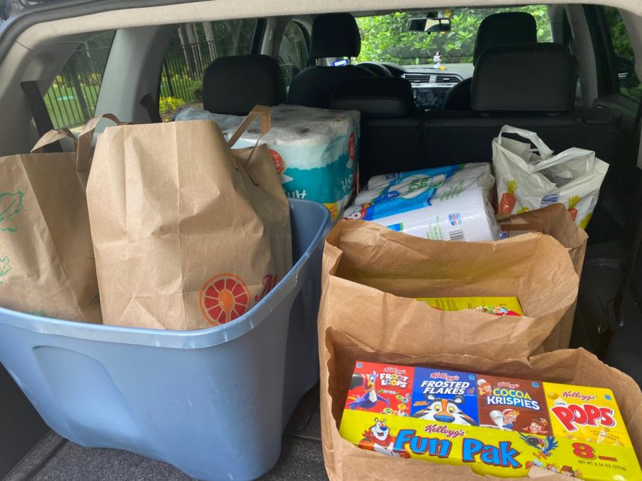 Community members participate in ACO food drive