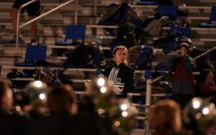 Lily Hager conducts the band during a pregame Friday night performance. This year concluded her seven-year band experience, as next year she will study Journalism at Texas A&M.