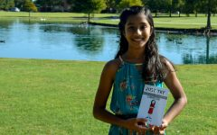 Fifth-grader, Venya Raju, is a published author of Just Try: Youll be surprised. Venya has the draft copy of her book, and is excited for the upcoming public release.