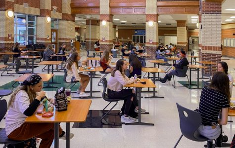 Sophomores Brinly Eaton, Natalia Duran De La Bega, Jillian Nuckles, and freshman Gianna Bierman eat lunch in the newly organized cafeteria. All desks are separated and face one way to promote social distancing.