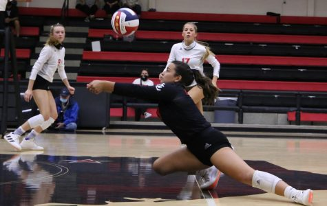 Senior Callie Kemohah makes a dig to save the ball. The Leopards won this game in three sets.